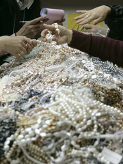 Buyers choose precious stones at the 19th International Jewellery Tokyo 2008 fair in Tokyo