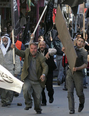 Palestinian protesters take part in an anti-Annapolis rally in Hebron