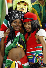 South African soccer fans pose before the Confederations Cup soccer match against Spain at the Free State Stadium in Bloemfontein