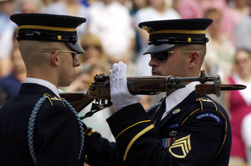 U.S. Army honor guard members participate in a changing of guard at the Tomb of the Unknowns before Memorial Day ceremonies at the Arlington National Cemetery near Washington