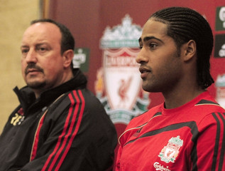 Liverpool's coach Benitez and new signing Johnson speak to media during a press conference at the clubs Melwood training complex in Liverpool