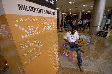 Software professional works on laptop at exhibition hall during inauguration of Microsoft Tech.ed India 2009 in Hyderabad