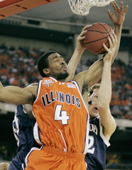 University of Illinois Luther Head fights for the rebound with University of Nevadas Nick Fazekas.
