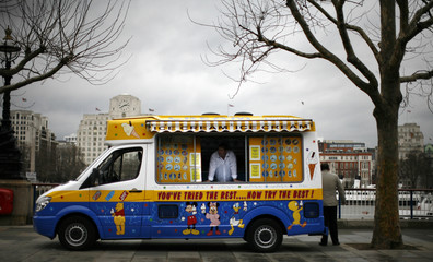 An ice cream vendor is seen inside a truck in front of the Tate Museum in London