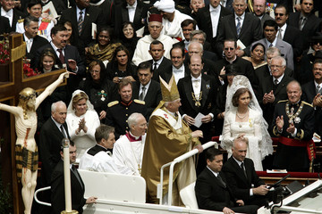 Pope Benedict XVI passes international delegates after his inaugural mass in St. Peter's Square in t..