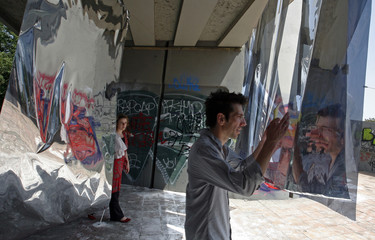 Two students walk through a passage decorated with metal sheets near to a central Prague's Underground station Vltavska