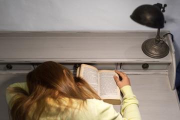 Asian woman sleeping on old book