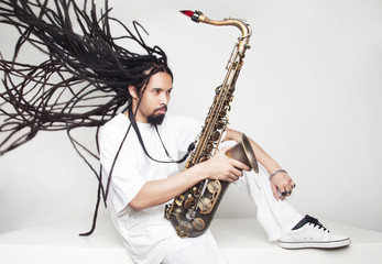 Male saxophonist with dreadlocks