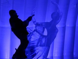 SCULPTOR WORKS ON AN ICE SCULPTURE DEPICTING A BALLERINA IN STPETERSBURG.