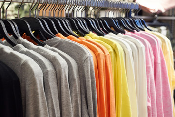 Clothing on hangers in store