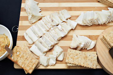 Sliced soft brie cheese and crispy bread