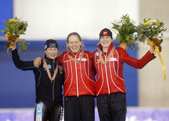 The top three finishers in the women's 3000m race take the podium in Calgary