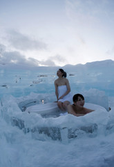 Women bathe at an outdoor bathroom of an ice hotel in Shimukappu town