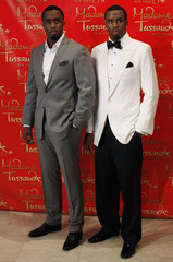 """Sean """"Diddy"""" Combs poses next to his wax figure replica at Madame Tussauds in New York"""