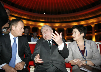 Poland's PM Tusk, former Polish president Walesa and Mayor of Warsaw Waltz chat at the Palace of Culture in Warsaw