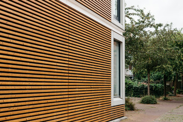 Modern architecture facade with lining of wood slats