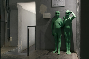 two young kids dressed as green aliens