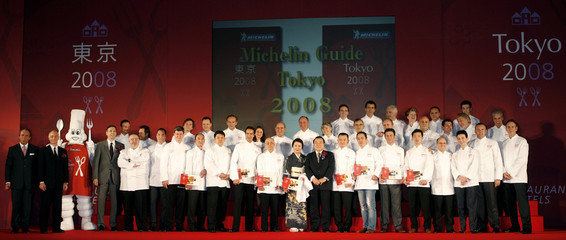 """Chefs and officials pose for photographers at a party for the publication of """"Michelin Guide Tokyo 2008"""" in Tokyo"""
