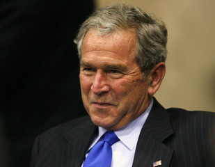 U.S. President George W. Bush smiles during a meeting with business executives at the APEC summit in Lima