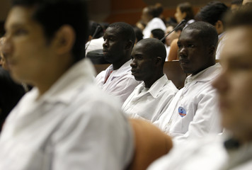 Doctors listen during the First International Meeting of Graduates from Cuba's Latin American Medical School in Havana