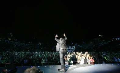 Lead singer Bono of the rock band U2 performs during a concert at Rose Bowl in Pasadena