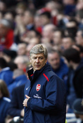Arsenal's manager Wenger watches play against Reading during their English Premier League soccer match in London