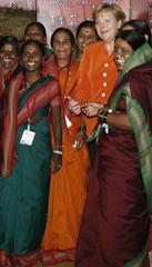 German Chancellor Merkel poses with women in Mumbai