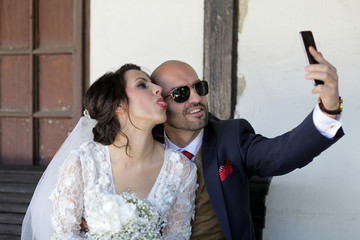 Wedding couple takes a selfie