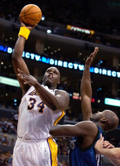 LAKERS SHAQUILLE ONEAL SHOOTS OVER TIMBERWOLVES MARC JOHNSON.