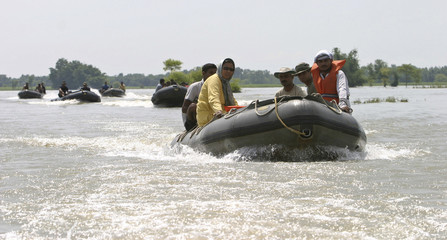Indian soldiers move in the flood-affected areas at Laxmipur village