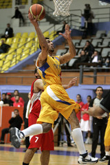 Sabra of Lebanon's Al-Riyadi goes to the basket against Syria's Al Jeish during their West Asian Clubs Championship basketball game in Amman