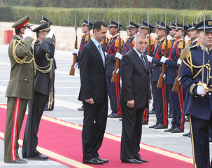 Syria's President Bashar al-Assad and his Croatian counterpart Stjepan Mesic reviewing honour guard in Damascus