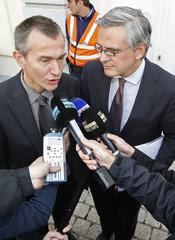 Belgium's Flemish Region President Peeters and Flemish Region employment Minister Vandenbroucke speak to journalists in Brussels