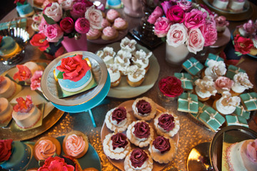 Pink, white and blue floral cakes served on little plates