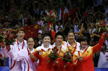 Medallists celebrate with their medals after women's doubles badminton final at the Beijing 2008 Olympic Games