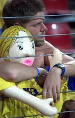 SWEDISH HUGS HIS BLOW UP DOLL AFTER DEFEAT BY ITALY IN THEIR GROUP B EUROPEAN CHAMPIONSHIP MATCH.