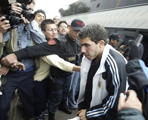 Argentine striker Carlos Tevez arrives in Lima for World Cup qualifier against Peru.
