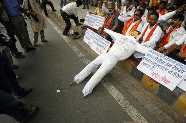 Activists of Shiv Sena hold placards and an effigy of China's President Hu during a protest in New Delhi