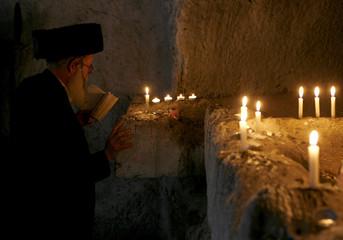 Ultra-Orthodox Jewish man recites prayers for Lag Ba-Omer on Meron mountain