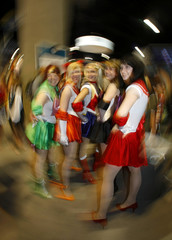 Girls dressed up as Sailor Moon comic characters attend the 39th annual Comic Con Convention in San Diego