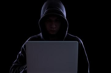 Anonymous hacker in the dark