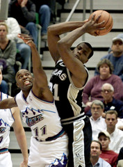 JAZZ VAUGHN AND SPURS ROSE STRETCH FOR REBOUND.