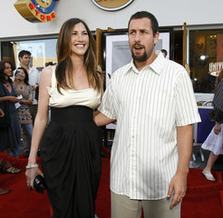 Adam Sandler poses with his wife Jackie at the premiere of I Now Pronounce You Chuck and Larry at the Gibson amphitheater in Universal City