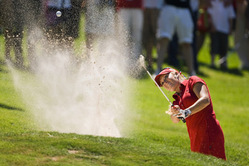 Gulbis of the U.S. chips out of a bunker on the 13th hole during 15th Women's Golf Masters in Evian