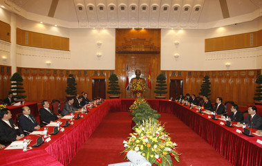 North Korea's PM Kim and his Vietnamese counterpart Nguyen Tan Dung talk at the Government Office in Hanoi