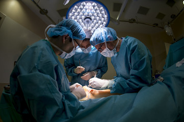 Surgeons doing an Achilles tendon surgery