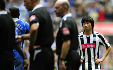 West Bromwich Albion's Kim reacts after being defeated by Portsmouth in their English FA Cup semi-final soccer match in London