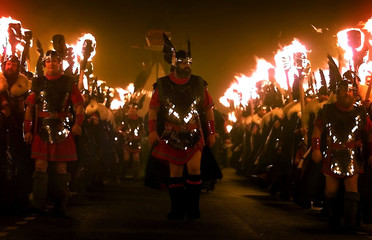 MAN DRESSED AS VIKING TAKES PART IN SHETLAND UP-HELLY-AA FESTIVAL.