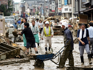 RESIDENTS REMOVE MUD AND HOUSEHOLD GOOD FROM FLOODED HOUSES IN NAKANOSHIMA TOWN, JAPAN.