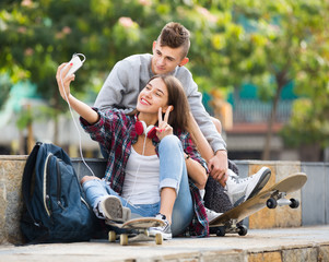 Two teenagers doing selfie together